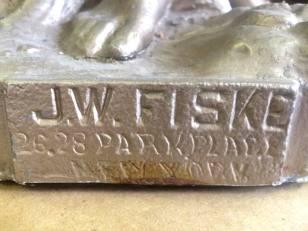 J. W. Fiske manufacturer of statue