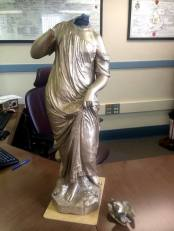 Vandalized statue waiting to be repaired