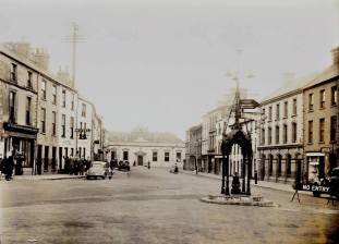 Circa early 1950s - Original font with finial has been removed. Source: Facebook/OldCarrickFergus